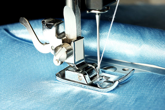 Textile sewing machine sewing industrial fabric.